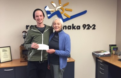 Jamie Larson of Radio Wanaka passing over a cheque to Trust member, Yvonne Gale