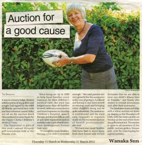 Wanaka Sun story on the 2012 Golf Tournament fundraiser, showing Laurel Gilks with a rugby ball for auction