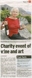 Wanaka Sun story on the Trust's 2014 Art and Wine in the Vines fundraiser, showing Laurel Gilks with some of the donated wine and tickets