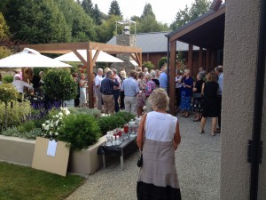 The guests at the Trust's 2014 Art & Wine in the Vines enjoying some wine and food in the sun